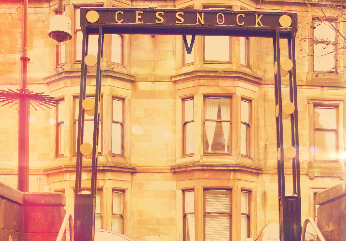 A photograph of the ornamental iron work at the entrance to Cessnock Subway Station - Glasgow