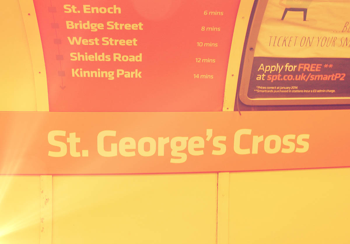 A shot of the St. George's Cross Outer Circle sign across the platform