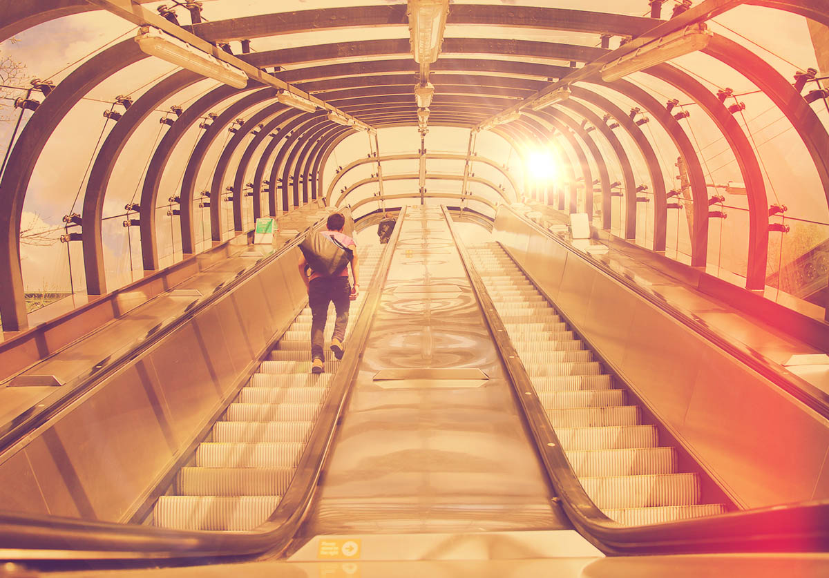 The escalators from the station to the bridge at Kelvinbridge Station