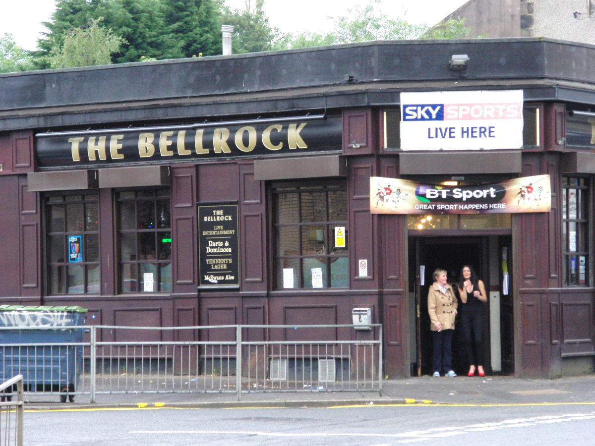 Two women having a fag outside the Bellrock pub